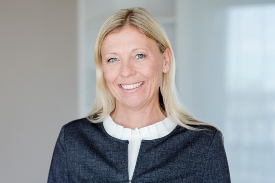 Portraitaufnahme von Monika Wagner, der Head of Asset Management bei THE FLAG.